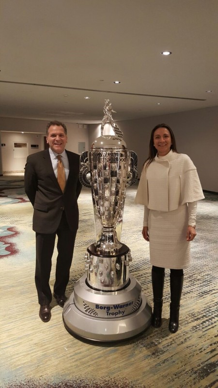 LIASE Group's John Bukowicz, Managing Director for the Americas and Vanessa Moriel, Managing Director Asia posing together with the Borg-Warner Trophy, which is presented every year to the winner of the Indy 500 race.