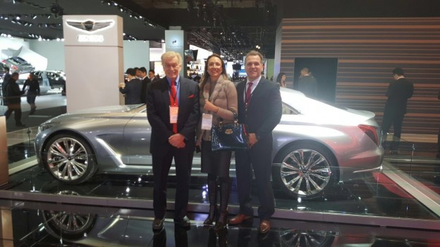 Left to right: Vic H. Doolan, Non-Executive Member of the Board, LIASE Group; Vanessa Moriel, Managing Director Asia, Liase Group; and, John Bukowicz, Managing Director for the Americas, LIASE Group, pose in front of new the new Genesis G90 luxury car by Hyundai.