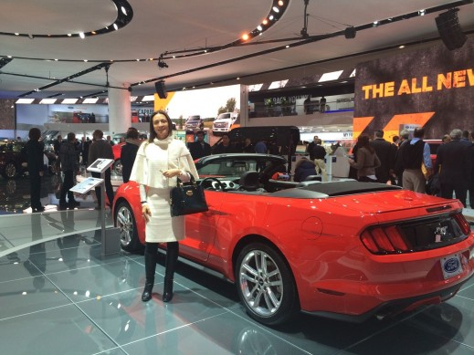 Vanessa Moriel, Managing Director Asia, Liase Group poses for a picture next to a convertible Ford Mustang.