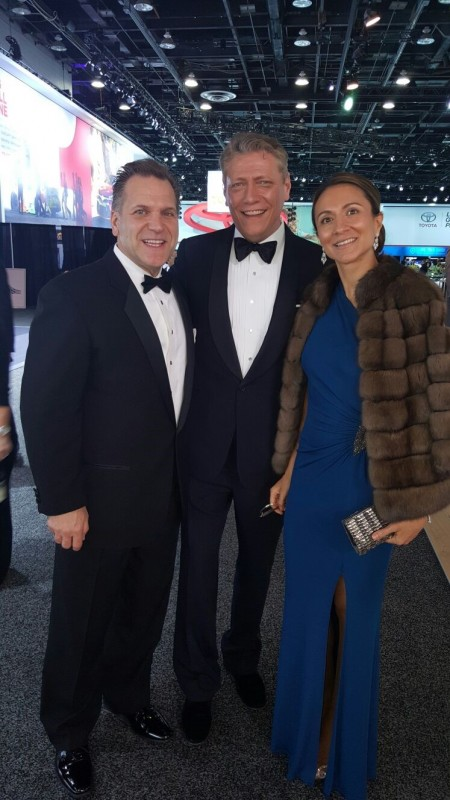 John Bukowicz, Managing Director for the Americas, LIASE Group (left); a TV presenter (center) and Vanessa Moriel, Managing Director Asia, LIASE Group pose during the black tie gala at the Detroit Auto Show.