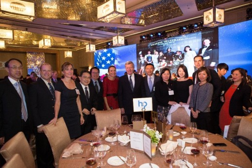 HCP Managing Director Asia Vanessa Moriel (middle left) and U.S. Ambassador to China Max Bacus (middle right) and senior automotive executives take a picture at the HCP table at the Am Cham Shanghai 100th anniversary gala.