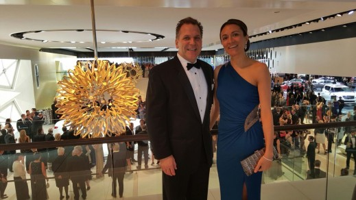 John Bukowicz, and Vanessa Moriel take a picture above the crowd during the black tie gala.