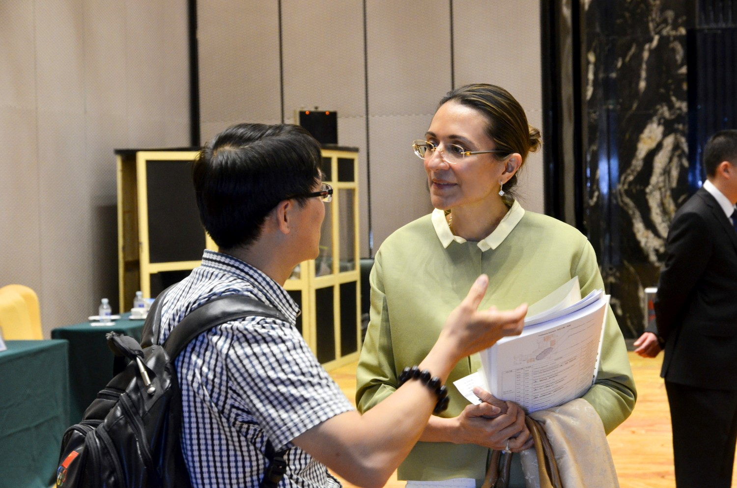 Vanessa Moriel, LIASE Group, Managing Director Asia speaks with a journalist.