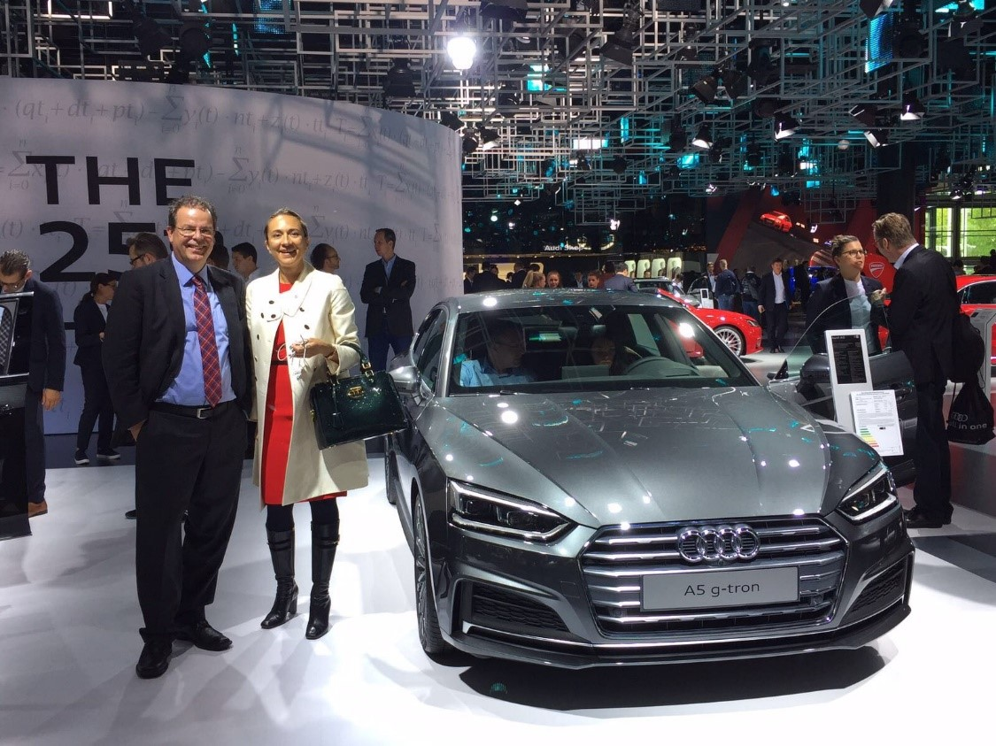 Vanessa and Wolfgang next to the Audi A5 g-tron, which can run on a choice of climate-friendly Audi e-gas, natural gas (CNG) or gasoline.