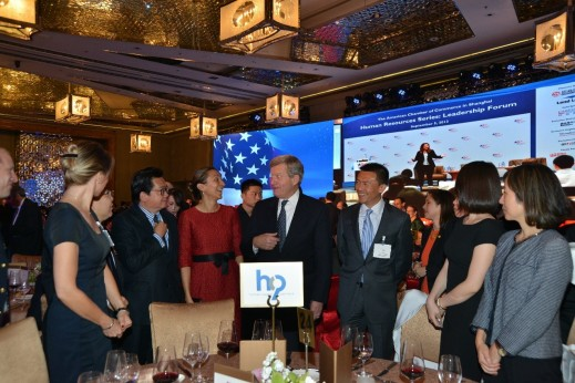 Max Bacus conversing with senior automotive executives and HCP MD Asia Vanessa Moriel at the HCP table during the AmCham 100th anniversary gala.