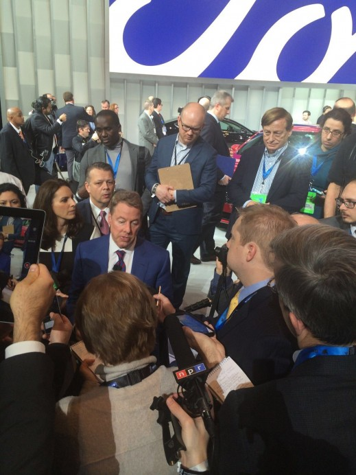 Bill Fords, Executive Chairman, Ford Motor Company, in the middle of a press scrum at the Detroit Auto Show.