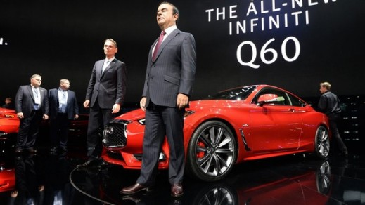 Nissan CEO Carlos Ghosn standing in front of the company's latest Infiniti Q60 sports sedan.
