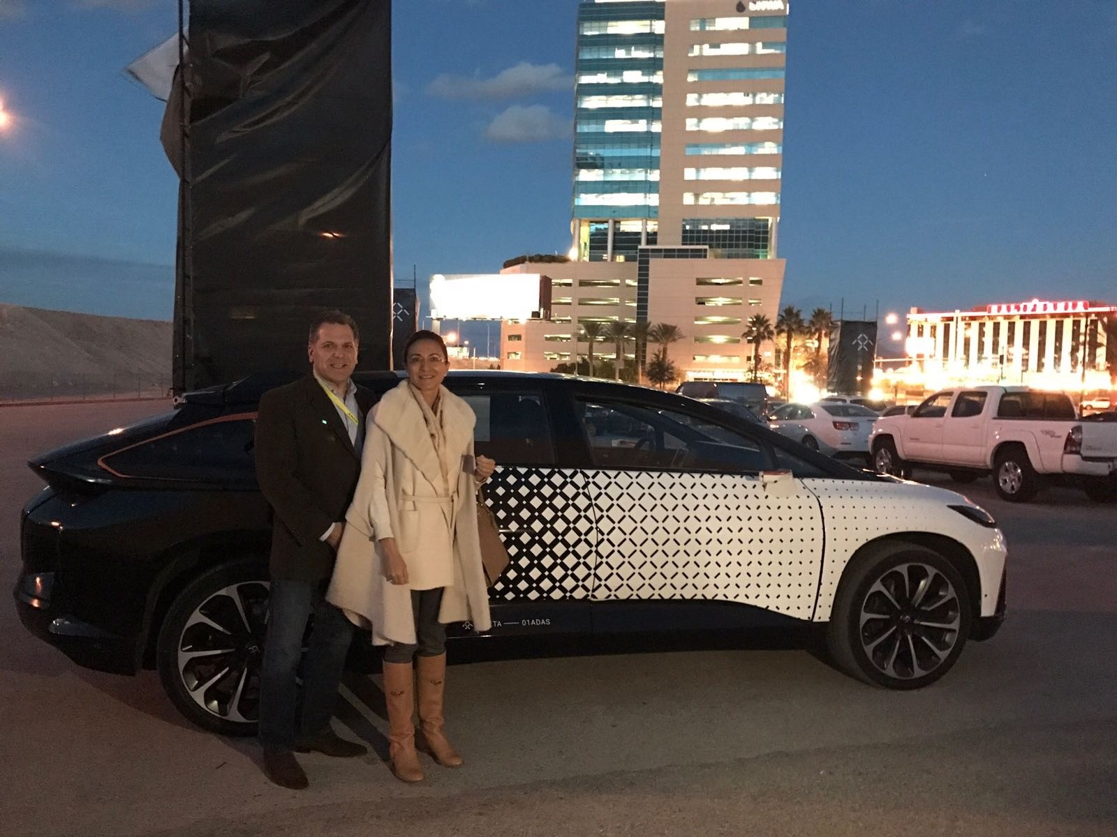 John Bukowicz, LIASE Group Managing Director Americas (left) and Vanessa Moriel, LIASE Group Managing Director Asia (right) pose in front of the FF91 reveal outside of CES 2017 in Las Vegas.