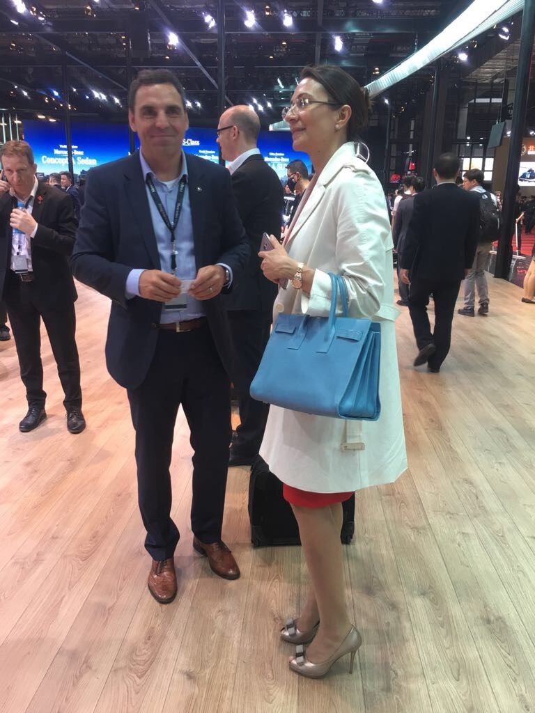 Vanessa Moriel speaking with a Mercedez-Benz Executive.