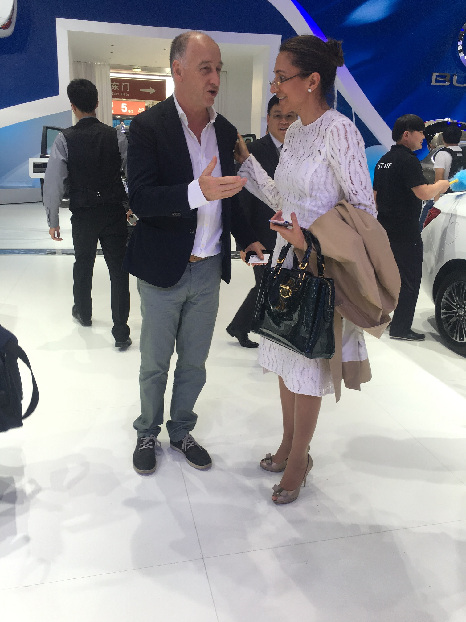 Kevin Wale, previous President and Managing Director of General Motors China and LIASE Group Managing Director Vanessa Moriel discuss on the sidelines of the 2016 China Auto Show in Beijing.