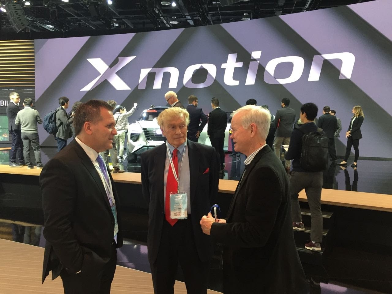 LIASE Group's Vic Doolan (middle) with a renowned Detroit auto journalist at the Xmotion Nissan booth.
