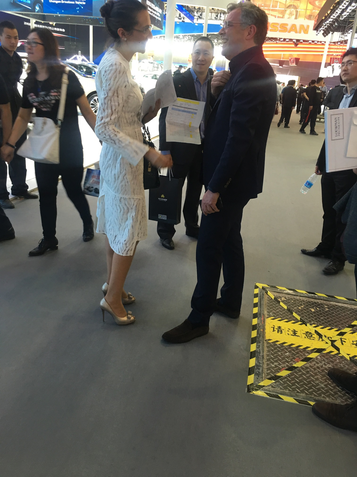 Vanessa Moriel exchanges a few words with a Volvo Global Executive during the press day at the Beijing Auto Show.