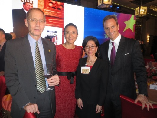AmCham President Kenneth Jarrett (left) and HCP Managing Director Asia Vanessa Moriel (second from the left) pose for a picture with colleagues.