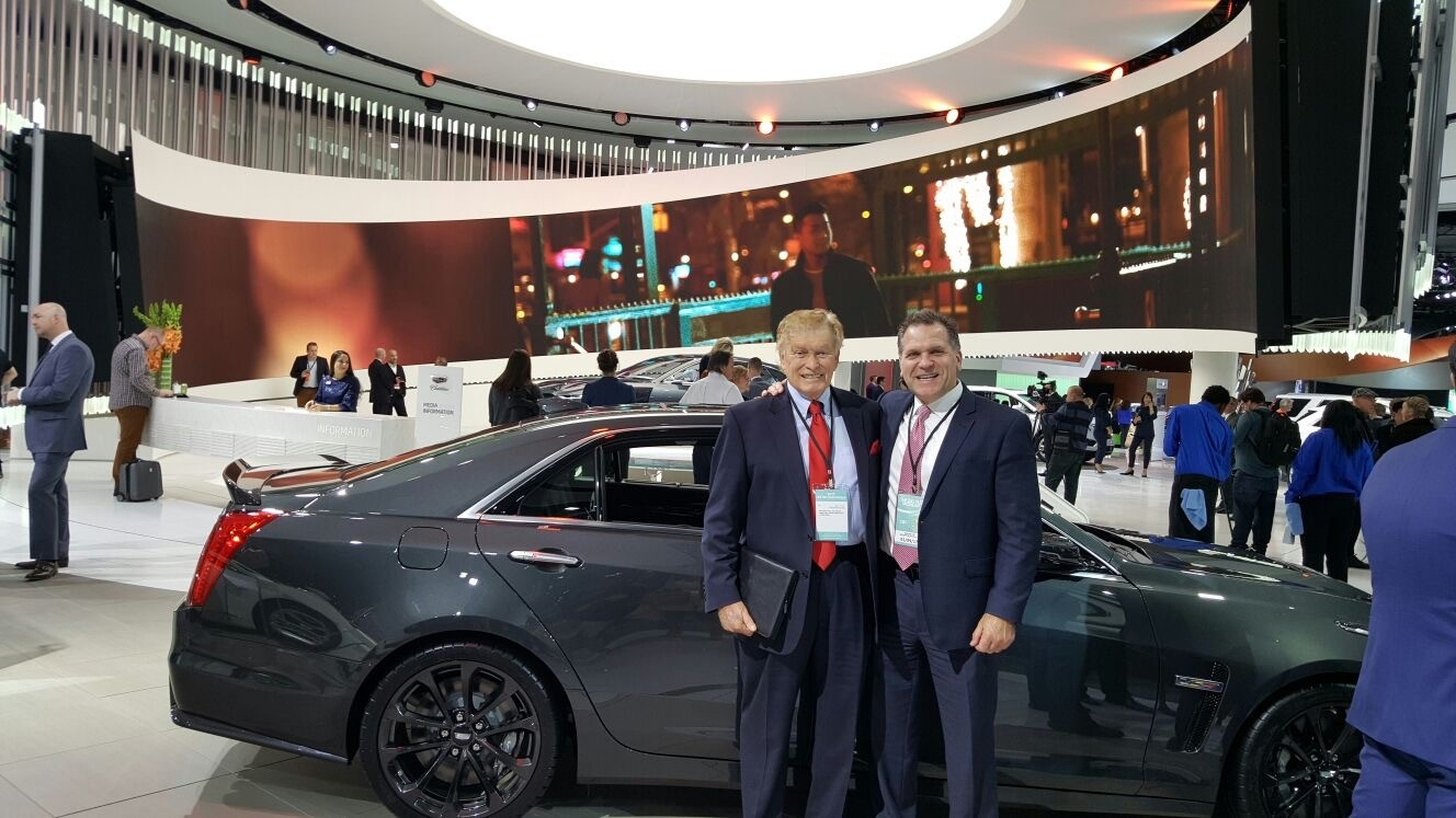 John Bukowicz and Vic Doolan stop to take a picture during the Detroit Auto Show.