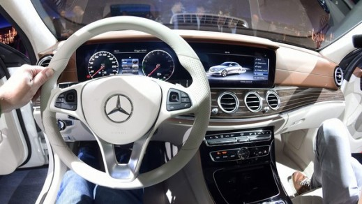 "The interior of the new Mercedes-Benz E-Class unveiled at CES 2016 feature ""touch-sensitive"" controls on the steering wheel."