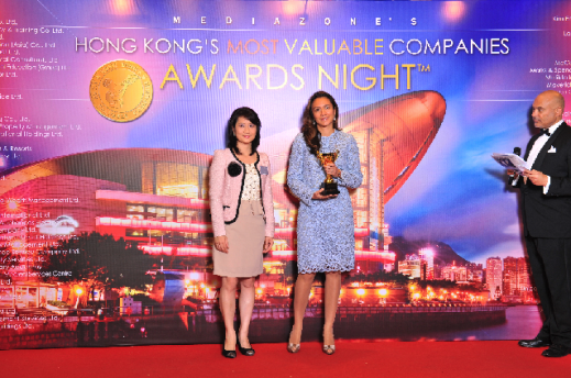Vanessa Moriel posing with the Trophy of Excellence at Hong Kong´s Most Valuable Companies awards night.