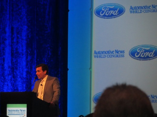 Ford COO, Mark Fields, presenting at the Automotive News Conference at the 2014 Detroit Auto Show.