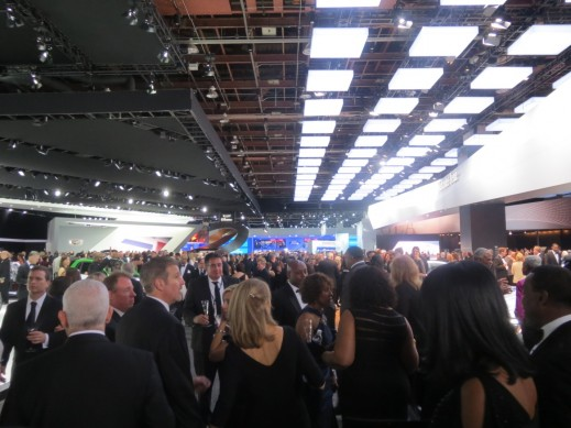 Vibrant crowd at the black tie charity ball of the Detroit Auto Show.