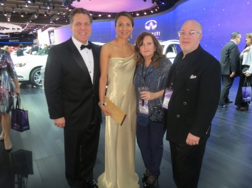 Michigan-based Movie Director, John Lauri, and his wife, pose with Vanessa and John at the Infiniti booth during the black tie charity ball.